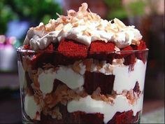 Red Velvet Trifle:    Ingredients  Carton heavy whipping cream, cold  Powdered sugar  Coconut extract  1 store-bought red velvet cake (unfrosted)  Toasted coconut flakes    Directions  In a large glass bowl, combine the heavy whipping cream and sugar. Beat with a hand mixer until thick and foamy. Add a small drizzle of coconut extract. Continue to whip until soft peaks appear.    Using a serrated knife cut the red velvet cake into 1-inch squares. Add about 1/3 of the squares to the bottom of…