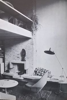 1960s interior fire place with a pretty concrete surrounding bricks and all it needs to make me wanna move in