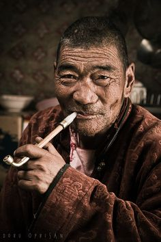 Nomad smoking in his tent - Mongolia