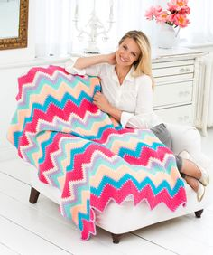 Every eye will be drawn to this cheerful This afghan is a pairing of bright and cool colors, and the zingy zigzag pattern adds that punch of pizzazz to your room!