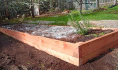 How to build a raised garden bed on sloping, uneven ground | Eartheasy Blog