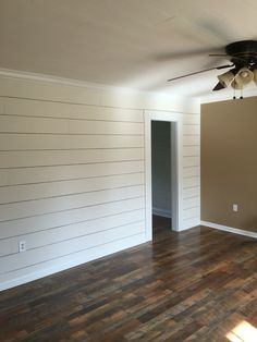 "Client remodel. Faux shiplap wall with larger 1/8"" spacing and Pergo Max flooring in River Road Oak"