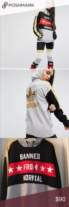 Banned From Normal Hoodie by Adidas Originals Exude tough-girl vibes in this cool colour block oversized hoodie with Banned From Normal slogan, an exclusive from the Rita Ora range by Adidas Originals. 70% Cotton, 30% Polyester. Machine wash. Adidas Tops Sweatshirts & Hoodies
