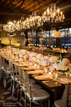 Anna and Spencer Photography Atlanta Wedding Photographers. Wedding Reception at Summerour in Atlanta. Farm tables, gold chargers, white & pink flowers, chiavari chairs, and chandeliers in an industrial setting.