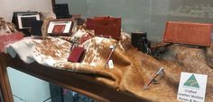 Australian made Adori wallets and pens displayed with a beautiful cowhide loaned from Stockman's Corner.