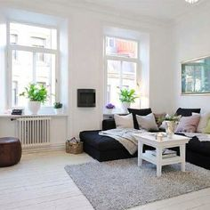 Small apartment decorating. Love the plants on the windowsills.