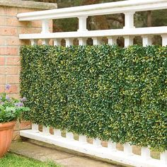 Conceal fences, walls, and railings with lush, natural looking faux greenery.