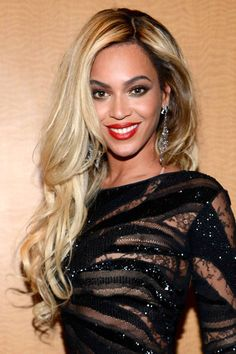 From Destiny's Child to Queen Bey, see 40 of Beyonce's  most memorable hair moments here.