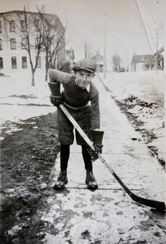 A family photo of Milt Schmidt as a fourteen year-old boy outside his family home in Kitchener, Ontario. Seven years ago, the NHL and the NHL Players' Association finally eased players' pension burden by establishing a supplemental Senior Benefit Plan for players 65 years of age and older. #NHL #hockey #lockout