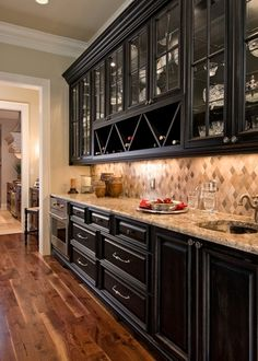 <3a well organized beverage station..love the cabinets and everything about this.