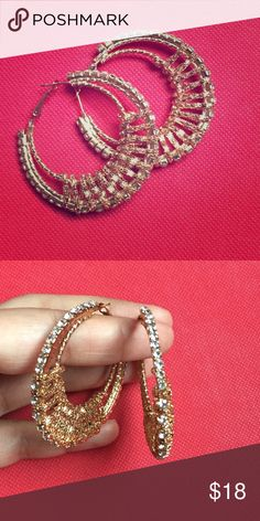 CZ and Gold chain wrap hoop earrings Double hoop earrings wrapped with gold chain and beautified front with CZ.     CLOSET RULES 🌟No trade🌟 🌟No lowballs 🌟 🌟All reasonable offers considered🌟 🌟Bundle and save: 10 % off 2 or more items🌟 🌟Ask me for customized bundles and save on shipping 🌟 Jewelry Earrings