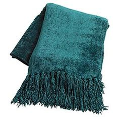 "Shaded Spruce Chenille Throw    $39.95  Chenille is the French word for caterpillar, and while our Chenille Throws weren't spun by a caterpillar, they are still incredibly soft with an iridescent sheen.    Color: Teal  Size: 50""W x 0.25""D x 60""H  Dry clean only"