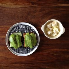 breakfast: avocado / cucumber toast with sea salt / basil butter / ground pepper & fresh cut fruit with raw honey