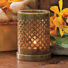 Brighter Home™ by PartyLite Soapstone Tealight Holder - Artisans in India handcraft each holder with clover-shaped piercings. Natural variations in color make each piece unique and one of a kind.