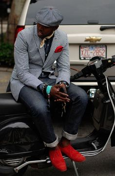 A monochrome gingham sportcoat and dark grey jeans are a great outfit formula to have in your arsenal. Round off this look with red suede brogues.  Shop this look for $803:  http://lookastic.com/men/looks/flat-cap-scarf-pocket-square-longsleeve-shirt-blazer-jeans-brogues/7159  — Grey Flat Cap  — Tan Silk Scarf  — Red Pocket Square  — Charcoal Longsleeve Shirt  — Black and White Gingham Blazer  — Charcoal Jeans  — Red Suede Brogues