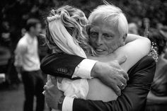 Bride hugs father at her wedding at Alberton House, Mt Albert, Auckland. Black and white.  BeSo Studios create beguiling fine art family photographs for the walls of the most discerning clients homes. We specialise in wedding and family portrait photography, and supply prints on the highest quality media, framed in beautiful conservation standard frames. We are a high end studio located in the beautiful city of Auckland, New Zealand.