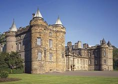 The Palace of Holyroodhouse, the official residence in Scotland of Her Majesty The Queen, stands at the end of Edinburgh's Royal Mile agains... the Royal Collection
