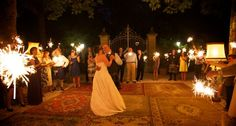 The first dance with all the guest holding sparklers, love the carpets