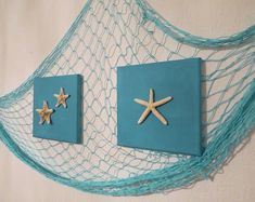 Set of two blue canvases with starfishes and a fishnet - Coastal decor - Beach art - Nautical wall decor by TvDEcoArt on Etsy Nautical Wall Decor, Beach Wall Decor, Coastal Decor, Fish Net Decor, Fishing Nursery, Beach Signs Wooden, Daisy, Mermaid Bedroom, Beach Themes