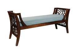 Manhattan Bench. Made of mahogany solids, this elegant bench brings a classic look to any room. Swirls of rattan embellish the sides and sky blue upholstery on the cushion lend a light elegant look to the seat.