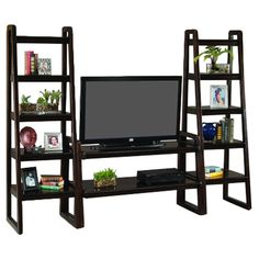 Flanked by 2 trestle-style etageres, this walnut-finished media console is perfect for organizing your DVD collection and showing off favorite trinkets. ...