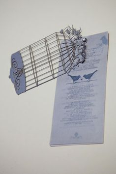 Bird Cage Invitation  A luxurious layered invitation,  crowned by our delicate cut-out birdcage  with your custom monogramme. Three printed pagesare included: 1 - poem, 2 - invitation, 3 - map.  Card size: 100x210mm  Envelope size: 110x220mm