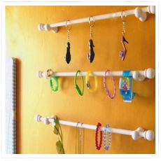 Bracelet/organizers holders for the wall (made out of curtain rods) -- so as to move 'em out of the crowded jewelry box and off the counter
