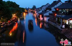 Xitang ancient Town, Zhejiang Province- While some of the traditions and customs for the Spring Festival have been fading away among urban citizens, in Xitang, a watertown renowned for its wandering rivers and time-honored architecture people still perform grand traditional ceremonies to celebrate Spring Festival.