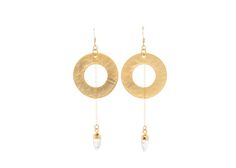 The Miraya Earrings are perfectly edgy, yet chic! Each moonstone spike charm hangs delicately from a length of 14k gold filled chain and through a gold plated circle. Nickel free. ♥ Please be aware that due to the unique and handmade nature of each product, colors, shapes and bead sizes