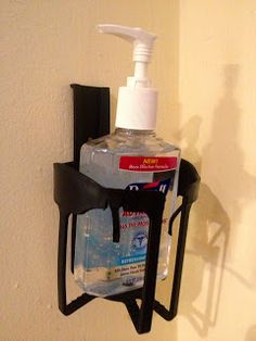Gel in, Gel out,...with DIY Hand Sanitizer Stations next to the front and back doors. Made from plastic automobile cup-holders from Walmart (under $2.00 for pkg of 4). Just snap off bent portion at top of cup-holder and nail to wall,...holds medium size hand sanitizer securely.