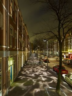 Pedestrians experience pools of light and dark at Broken Light in Rotterdam, Netherlands