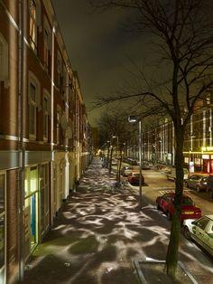 Pedestrians experience pools of light and dark at Broken Light in Rotterdam, Netherlands