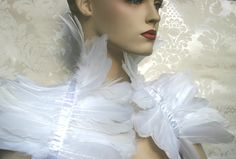 BEAUTIFUL GOTHIC/ BURLESQUE TIE ON WHITE SWAN FEATHER SHRUG / BOLERO HAND MADE IN YORKSHIRE BY FEMME GOTHIQUE.  HANDMADE WITH LOVE IN YORKSHIRE  BEAUTIFUL WHITE SWAN FEATHERS ON GORGEOUS WHITE RIBBON AND TIES AT THE BACK WITH 1 WHITE DOUBLE SATIN RIBBON  CAN BE WORN OVER ANY ITEM OF CLOTHING OR ON ITS OWN IF YOU DARE.   ONE SIZE FITS ALL   All our items are carefully hand made to order and can take up to 10 days to be posted.  If you have any questions please get in touch, we would ...