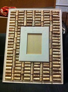 Old cork board, hobby lobby frame,  chalk paint.  Cut corks in half and glued around frame.  Double sided Velcro glued to back of frame allows for change of photo!