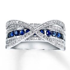 This elegant ring for her features a center row lined with natural sapphires and interlocking waves of round diamonds. Additional diamonds line rows above and below the center row to complete the look. Styled in 10K white gold.