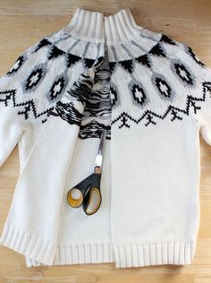 http://www.ehow.com/ehow-crafts/blog/transform-a-pullover-to-cardigan-sweater-jacket/