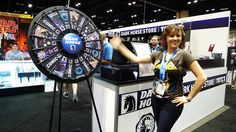 Kari from Dark Horse spinning the prize wheel! Buy this Prize Wheel at http://PrizeWheel.com/products/floor-prize-wheels/floor-table-black-clicker-prize-wheel-18-slot/.
