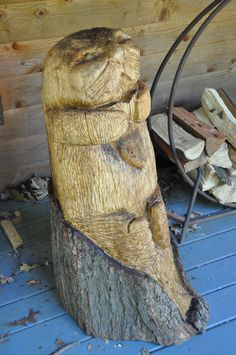 """Stick"" the Sea Otter (named by my nephew).  Hand carved wooden sculpture."