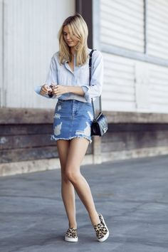 Love the sneakers. 20 Modern Ways to Style a Denim Skirt for Spring | StyleCaster