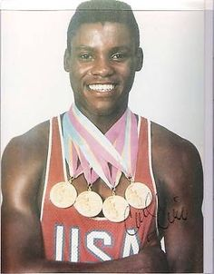 CARL LEWIS (1984 OLYMPICS) Signed 8x11 Color Photo