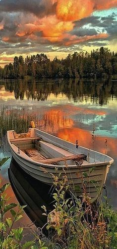 AMAZING SWEDEN⠀⠀⠀⠀ #Photo by Maria Canavello Mrasek.bytheriver⠀⠀ ⠀⠀#landscape nature river sea lake boat sky sunset clouds forest reflection⠀⠀⠀⠀⠀