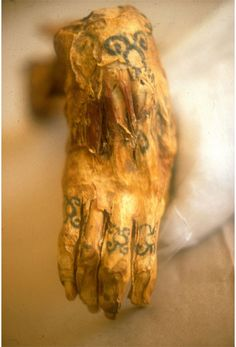 Hand of a mummy, showing off ancient tattoos.    Amazing!