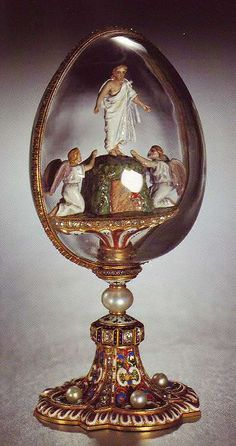 The Resurrection Egg by Faberge ca 1887. Made of yellow gold, rock crystal, rose-cut diamonds, pearls, brilliant diamonds and various coloured enamels. It is one of Faberge's masterpieces and is essentially a jewel. http://www.mieks.com/faberge-en/Other-Eggs/Imperial-Resurrection-Egg.htm