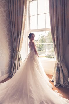 Bridal portrait by the window at The Great Southern Hotel, Killarney, Co. Kerry, Ireland.