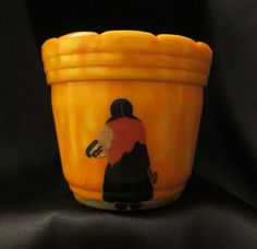 Vintage RARE Medium (4 inches tall) Planter/Flower Pot by Akro Agate Company, Orange Marbleized/Slag Glass with Hand painted Woman. $49.00, via Etsy.