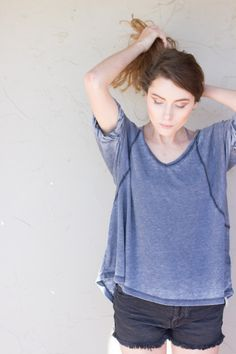 Free Fallin Tee // Slouchy, oversized fit, in a so-soft burnout jersey. Ribbed V-Neck with rolled short sleeves. Subtle Hi-Lo hem // $58 #freepeople #shoplocal #antiquegarden