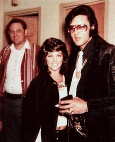 Elvis and Priscilla Presley in Tupelo, MS to collect another badge from Tupelo Police Department, December 29, 1970.