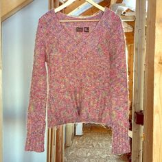 BRE Denim Sweater Multicolored super soft and warm sweater. Mostly pink with blue and green. Long sleeves with long cuffs that can be rolled up once if you like. Sweaters V-Necks