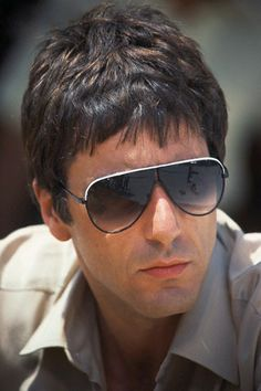 855ea3361ccf The famous bad-ass that Tony Montana wears throughout the movie are  originals. The sunglasses are black framed large with smoke color faded  lenses.