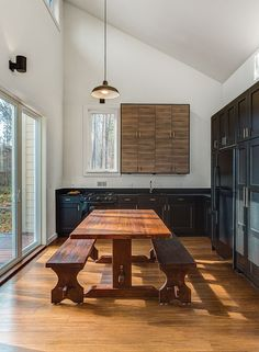 """To keep costs down elsewhere (the house was built for just over $118,000), architect Brun and his partner Lizmarie Esparza specified Ikea kitchen cabinets and a black refrigerator, which is less expensive than stainless steel. """"It was really important that the kitchen opened up to the outside deck. Its designed in an L-shape with an indoor-outdoor table,"""" Brun says. """"The idea is that when you open the door, there's a continuous environment connecting the inside with the outside—it's as ..."""